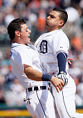 Jose Iglesias of the Detroit Tigers right chestbumps Ian Kinsler of the Detroit Tigers after hitting an RBIsingle to defeated the Chicago White Sox...