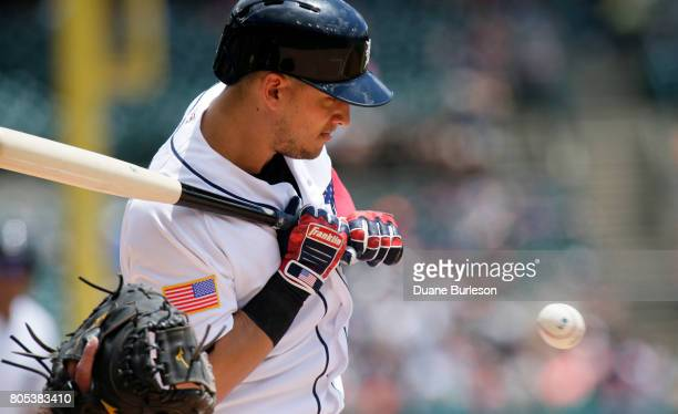 Jose Iglesias of the Detroit Tigers takes an inside pitch during the second inning of game one of a doubleheader against the Cleveland Indians at...