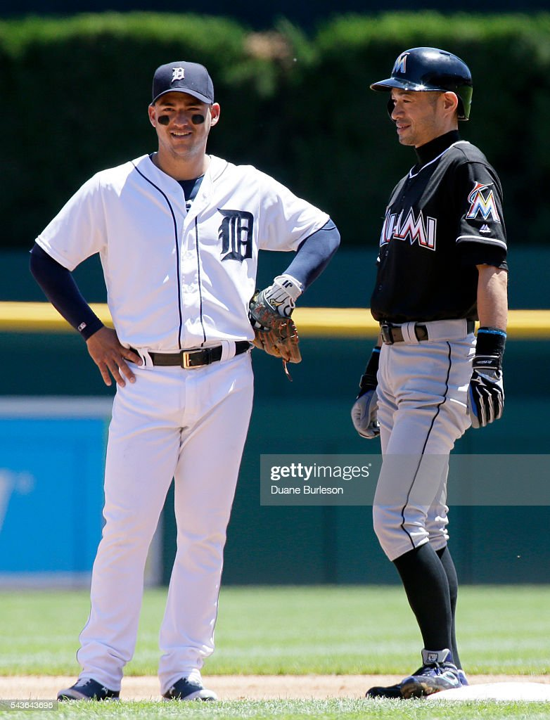 Jose Iglesias #1 of the Detroit Tigers talks with <a gi-track='captionPersonalityLinkClicked' href=/galleries/search?phrase=Ichiro+Suzuki&family=editorial&specificpeople=201556 ng-click='$event.stopPropagation()'>Ichiro Suzuki</a> #51 of the Miami Marlins during the second inning at Comerica Park on June 29, 2016 in Detroit, Michigan. The Tigers defeated the Marlins 10-3.