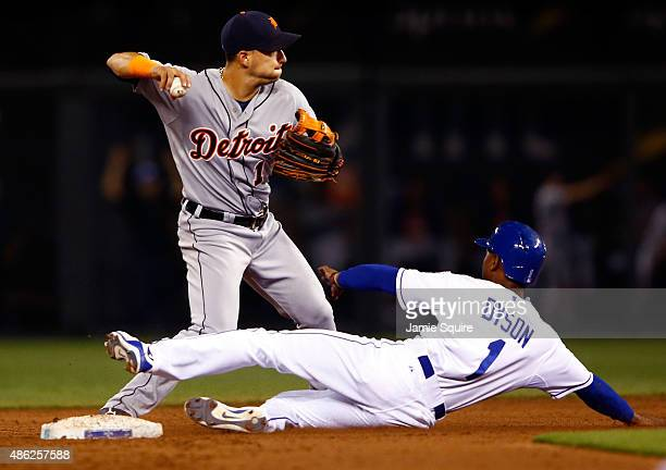 Jose Iglesias of the Detroit Tigers throws toward first for a double play as Jarrod Dyson of the Kansas City Royals slides during the game at...