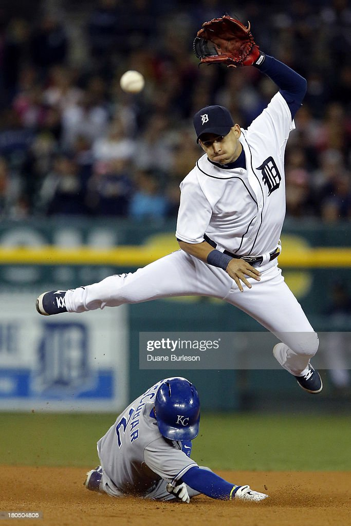 Jose Iglesias #1 of the Detroit Tigers turns the ball after getting a force out on <a gi-track='captionPersonalityLinkClicked' href=/galleries/search?phrase=Alcides+Escobar&family=editorial&specificpeople=4845889 ng-click='$event.stopPropagation()'>Alcides Escobar</a> #2 of the Kansas City Royals at second base in the ninth inning at Comerica Park on September 13, 2013 in Detroit, Michigan. Jarrod Dyson of the Kansas City Royals beat the throw and was safe at first.