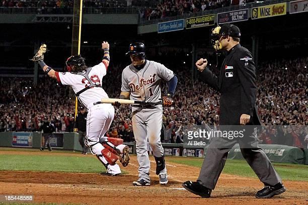 Jose Iglesias of the Detroit Tigers walks to the dugout as Jarrod Saltalamacchia celebares Koji Uehara of the Boston Red Sox endding Game Six...