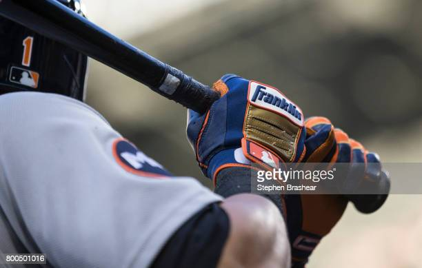 Jose Iglesias of the Detroit Tigers wears a pair of Franklin batting gloves while standing in the on deck circle during a game against the Seattle...