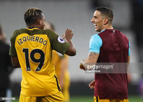 Jose Izquierdo and Anthony Knockaert of Brighton and Hove Albion celebrate victory after the Premier League match between West Ham United and...