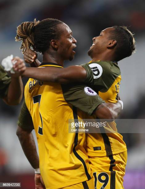 Jose Izquierdo and Gaetan Bong of Brighton and Hove Albion celebrate victory after the Premier League match between West Ham United and Brighton and...