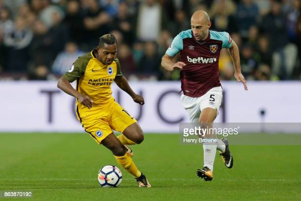 Jose Izquierdo of Brighton and Hove Albion is chased by Pablo Zabaleta of West Ham United during the Premier League match between West Ham United and...