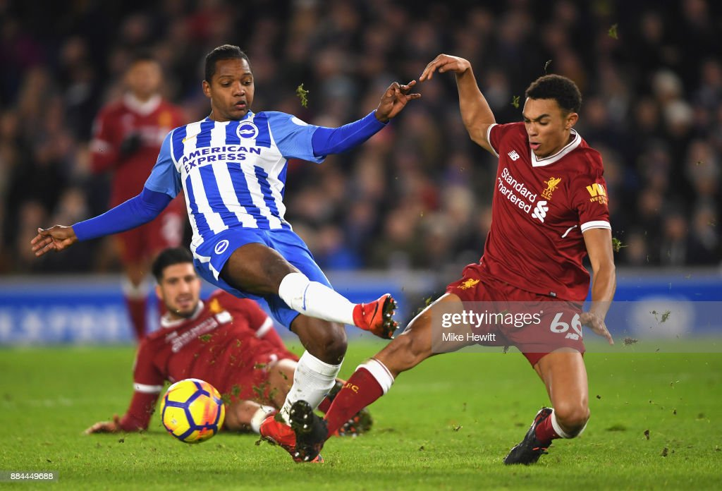 Jose Izquierdo of Brighton and Hove Albion shoots as Trent Alex Arnold of Liverpool attempts to block during the Premier League match between Brighton and Hove Albion and Liverpool at Amex Stadium on December 2, 2017 in Brighton, England.