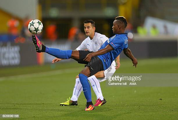 Jose Izquierdo of Club Brugge controls the ball as Luis Hernandez of Leicester City looks on during the UEFA Champions League match between Club...
