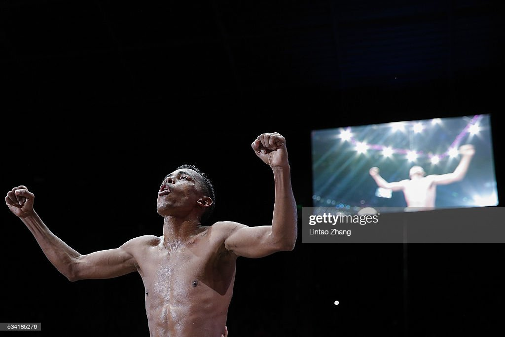 Jose Jimenez of Colombia celebrates his victory over Xiong Chaozhong of China during their IBF Mini Flyweight Eliminator boxing match at Beijing Olympic park diamond stadium on May 25, 2016 in Beijing, China.