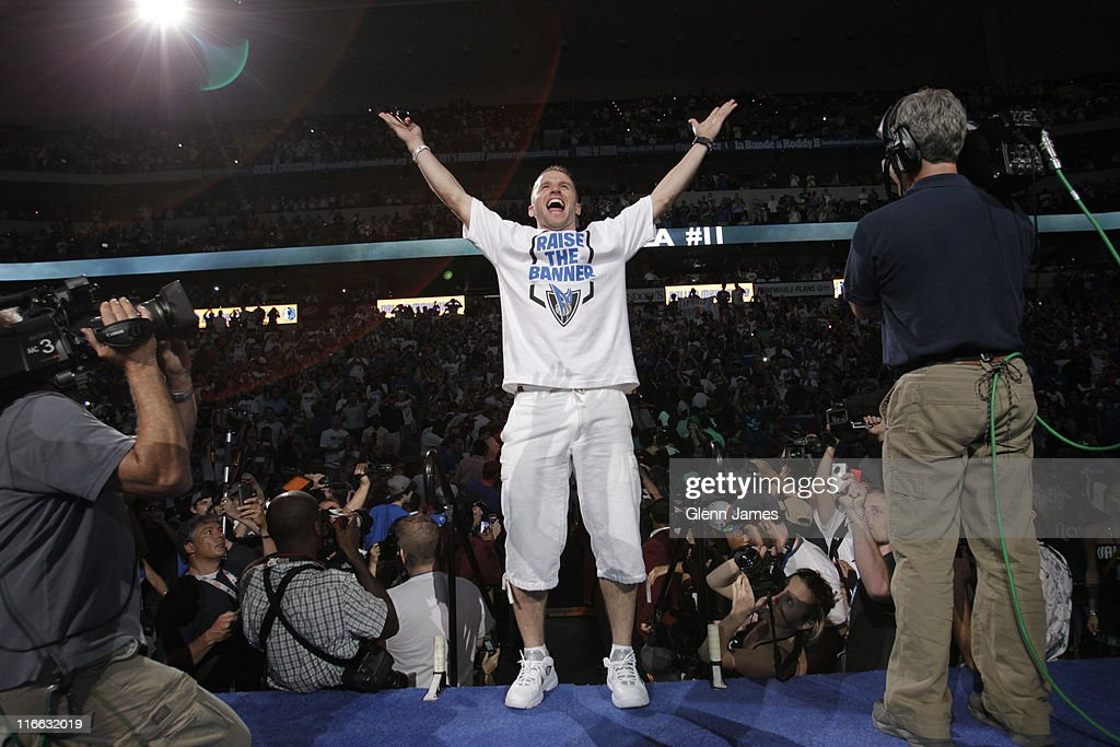 Jose Juan Barea of the Dallas Mavericks is introduced to the crowd during the Mavericks NBA Champion Victory Parade on June 16, 2011 at the American Airlines Center in Dallas, Texas.