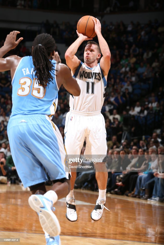 Jose Juan Barea #11 of the Minnesota Timberwolves aims over Kenneth Faried #35 of the Denver Nuggets during the game between the Minnesota Timberwolves and the Denver Nuggets on November 21, 2012 at Target Center in Minneapolis, Minnesota.