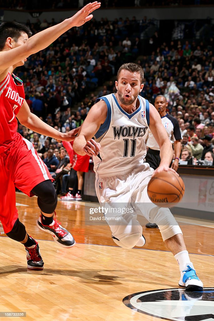 Jose Juan Barea #11 of the Minnesota Timberwolves drives against Jeremy Lin #7 of the Houston Rockets on December 26, 2012 at Target Center in Minneapolis, Minnesota.