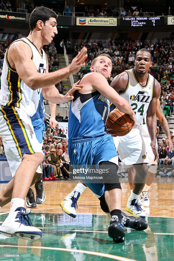 Jose Juan Barea #11 of the Minnesota Timberwolves drives to the basket against <a gi-track='captionPersonalityLinkClicked' href=/galleries/search?phrase=Enes+Kanter&family=editorial&specificpeople=5621416 ng-click='$event.stopPropagation()'>Enes Kanter</a> #0 and <a gi-track='captionPersonalityLinkClicked' href=/galleries/search?phrase=Paul+Millsap&family=editorial&specificpeople=880017 ng-click='$event.stopPropagation()'>Paul Millsap</a> #14 of the Utah Jazz at Energy Solutions Arena on January 2, 2013 in Salt Lake City, Utah.