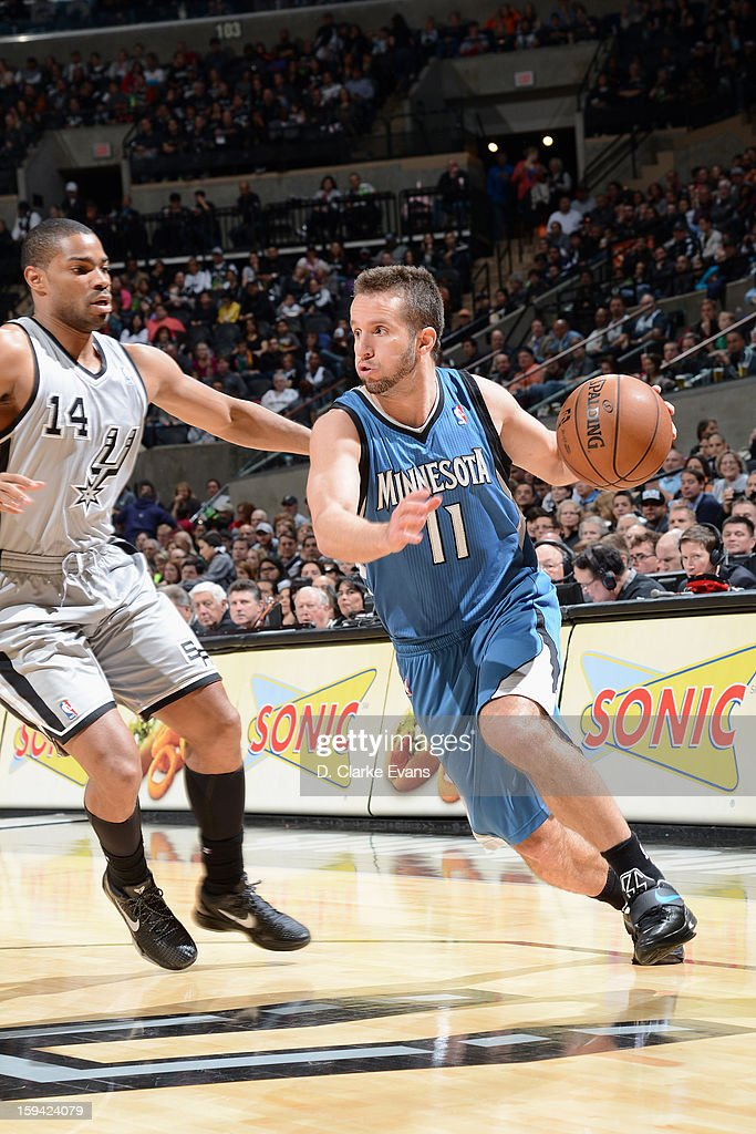 Jose Juan Barea #11 of the Minnesota Timberwolves handles the ball against Gary Neal #14 of the San Antonio Spurs on January 13, 2013 at the AT&T Center in San Antonio, Texas.