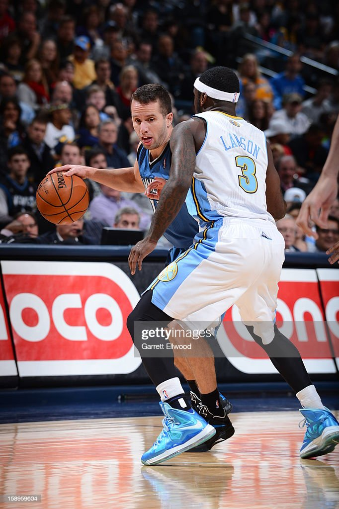 Jose Juan Barea #11 of the Minnesota Timberwolves handles the ball against <a gi-track='captionPersonalityLinkClicked' href=/galleries/search?phrase=Ty+Lawson&family=editorial&specificpeople=4024882 ng-click='$event.stopPropagation()'>Ty Lawson</a> #3 of the Denver Nuggets on January 3, 2013 at the Pepsi Center in Denver, Colorado.