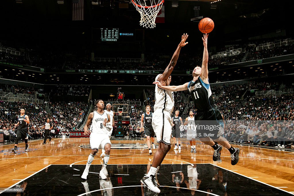 Jose Juan Barea #11 of the Minnesota Timberwolves shoots against <a gi-track='captionPersonalityLinkClicked' href=/galleries/search?phrase=Reggie+Evans&family=editorial&specificpeople=202254 ng-click='$event.stopPropagation()'>Reggie Evans</a> #30 of the Brooklyn Nets on November 5, 2012 at the Barclays Center in Brooklyn, New York.