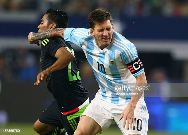 Jose Juan Vazquez of Mexico and Lionel Messi of Argentina during a international friendly at ATT Stadium on September 8 2015 in Arlington Texas