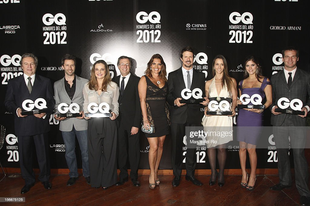 Jose Koechlin, Marco Zunino, Susana de la Puente, Rafael Molano, Jessica Newton, Rafael Osterling, Vania Masias, Anahi Gonzales Daly and Nicolas Fuchs pose during the awards ceremony GQ Men of the Year 2012 at La Huaca Pucllana on November 23, 2012 in Lima, Peru.