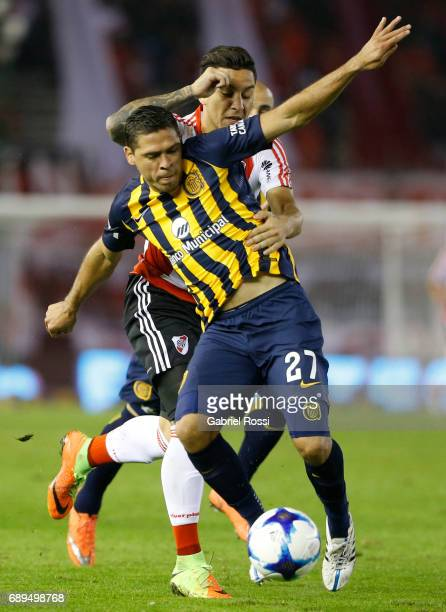 Jose Leguizamon of Rosario Central fights for the ball with Sebastian Driussi of River Plate during a match between River Plate and Rosario Central...