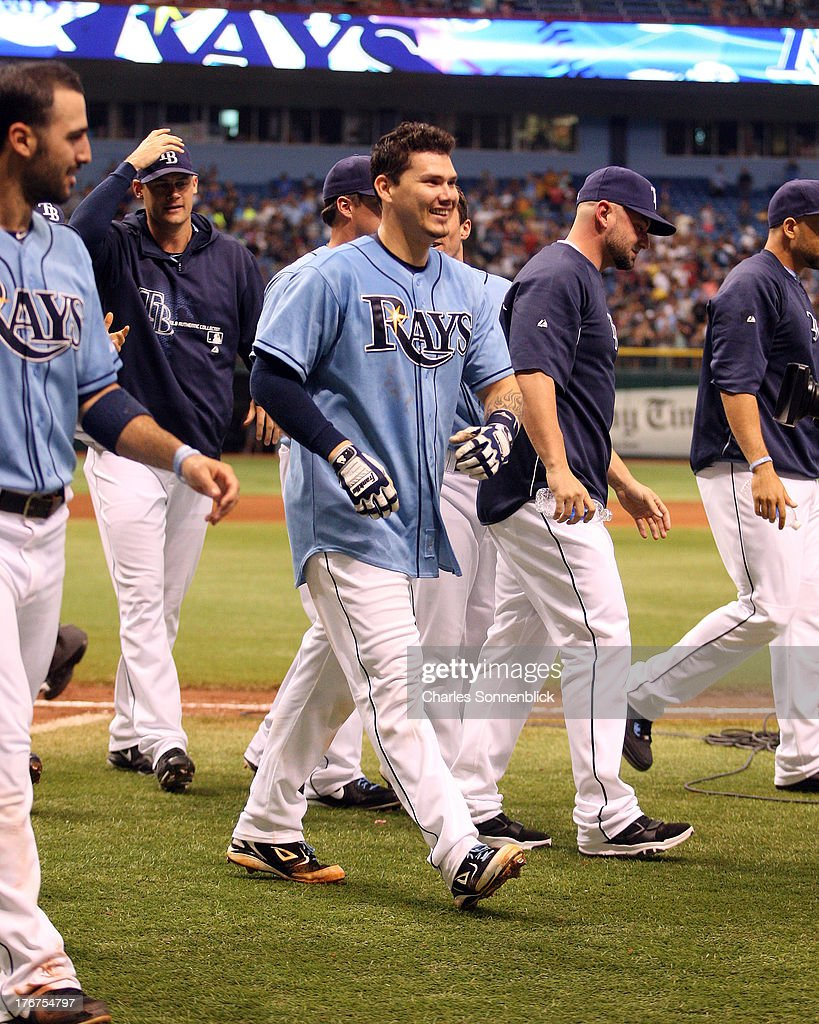 Jose Lobaton #59 of the Tampa Bay Rays is all smiles after hitting the winning homerun in the tenth inning against the Toronto Blue Jays during the game on August 18, 2013 at Tropicana Field in St. Petersburg, Florida.