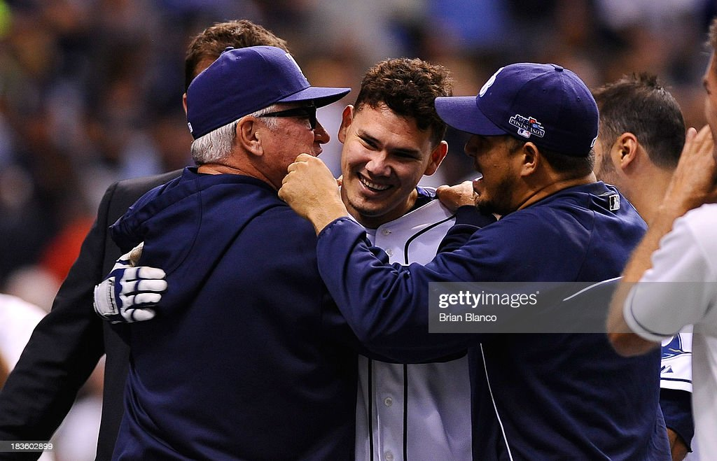 Jose Lobaton #59 of the Tampa Bay Rays is hugged by manager manager <a gi-track='captionPersonalityLinkClicked' href=/galleries/search?phrase=Joe+Maddon&family=editorial&specificpeople=568433 ng-click='$event.stopPropagation()'>Joe Maddon</a> #70 after hitting a walk off home run in the bottom of the ninth inning to defeat the Boston Red Sox during Game Three of the American League Division Series at Tropicana Field on October 7, 2013 in St Petersburg, Florida.