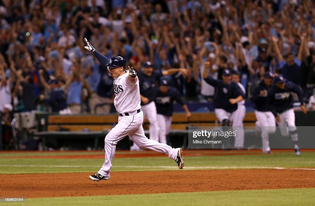 Jose Lobaton #59 of the Tampa Bay Rays rounds the bases after hitting a walk off home run in the bottom of the ninth to defeat the Boston Red Sox during Game Three of the American League Division Series at Tropicana Field on October 7, 2013 in St Petersburg, Florida.
