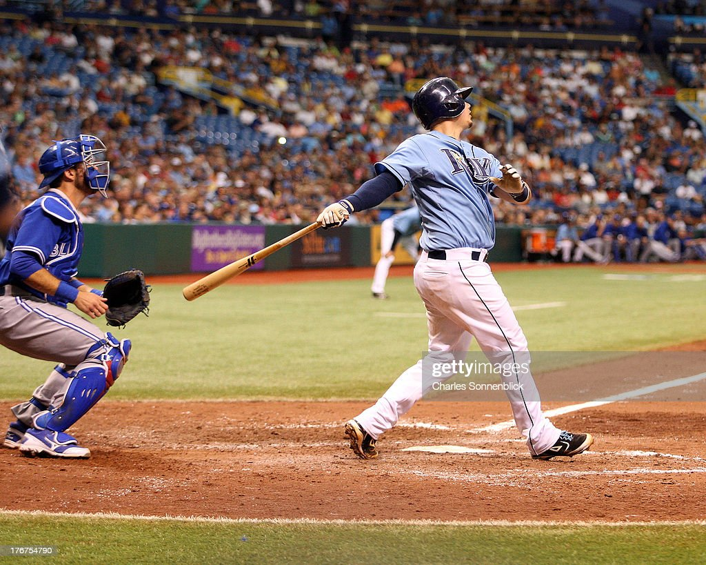 Jose Lobaton #59 of the Tampa Bay Rays watches his ball sail over the fence in the tenth inning against the Toronto Blue Jays during the game on August 18, 2013 at Tropicana Field in St. Petersburg, Florida.