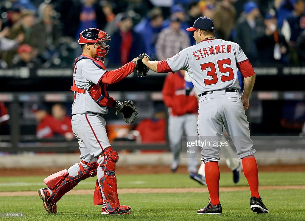 Jose Lobaton #59 of the Washington Nationals celebrates the win with teammate <a gi-track='captionPersonalityLinkClicked' href=/galleries/search?phrase=Craig+Stammen&family=editorial&specificpeople=5897564 ng-click='$event.stopPropagation()'>Craig Stammen</a> #35 on April 2, 2013 at Citi Field in the Flushing neighborhood of the Queens borough of New York City.The Washington Nationals defeated the New York Mets 5-1.