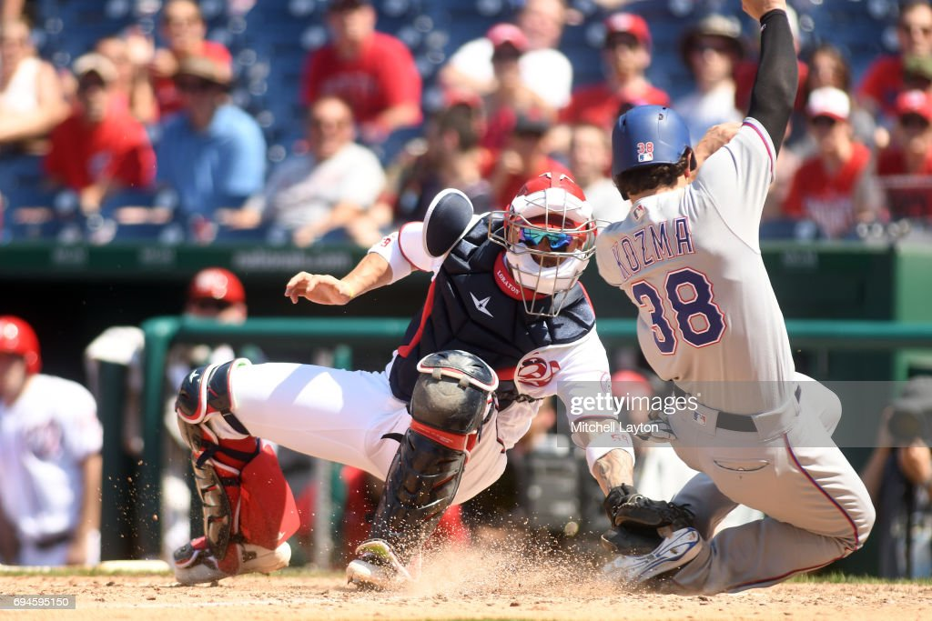 Jose Lobaton #59 of the Washington Nationals tags out Pete Kozma #38 of the Texas Rangers at the plat ein the ninth inning during a baseball game at Nationals Park on June 10, 2017 in Washington, DC. The Rangers won 6-3.