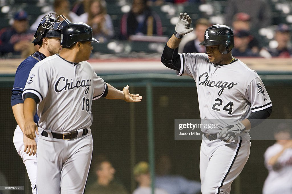 <a gi-track='captionPersonalityLinkClicked' href=/galleries/search?phrase=Jose+Lopez&family=editorial&specificpeople=239051 ng-click='$event.stopPropagation()'>Jose Lopez</a> #18 of the Chicago White Sox celebrates with <a gi-track='captionPersonalityLinkClicked' href=/galleries/search?phrase=Dayan+Viciedo&family=editorial&specificpeople=5720224 ng-click='$event.stopPropagation()'>Dayan Viciedo</a> #24 after Viciedo hit a two run home run during the second inning against the Cleveland Indians at Progressive Field on October 2, 2012 in Cleveland, Ohio.
