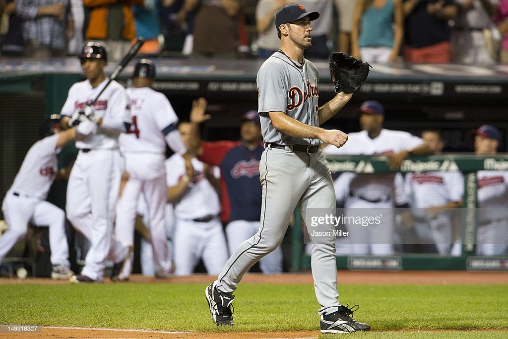 <a gi-track='captionPersonalityLinkClicked' href=/galleries/search?phrase=Jose+Lopez&family=editorial&specificpeople=239051 ng-click='$event.stopPropagation()'>Jose Lopez</a> #4 of the Cleveland Indians celebrates with teammates as starting pitcher <a gi-track='captionPersonalityLinkClicked' href=/galleries/search?phrase=Justin+Verlander&family=editorial&specificpeople=556723 ng-click='$event.stopPropagation()'>Justin Verlander</a> #35 of the Detroit Tigers walks back to the mound after giving up a run during the seventh inning at Progressive Field on July 26, 2012 in Cleveland, Ohio.