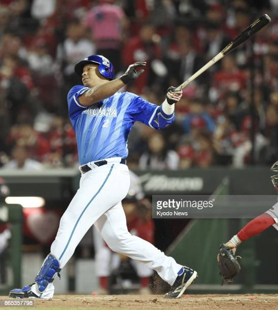 Jose Lopez of the DeNA BayStars hits a tiebreaking single in the fifth inning against the Hiroshima Carp in a Central League Climax Series finalstage...