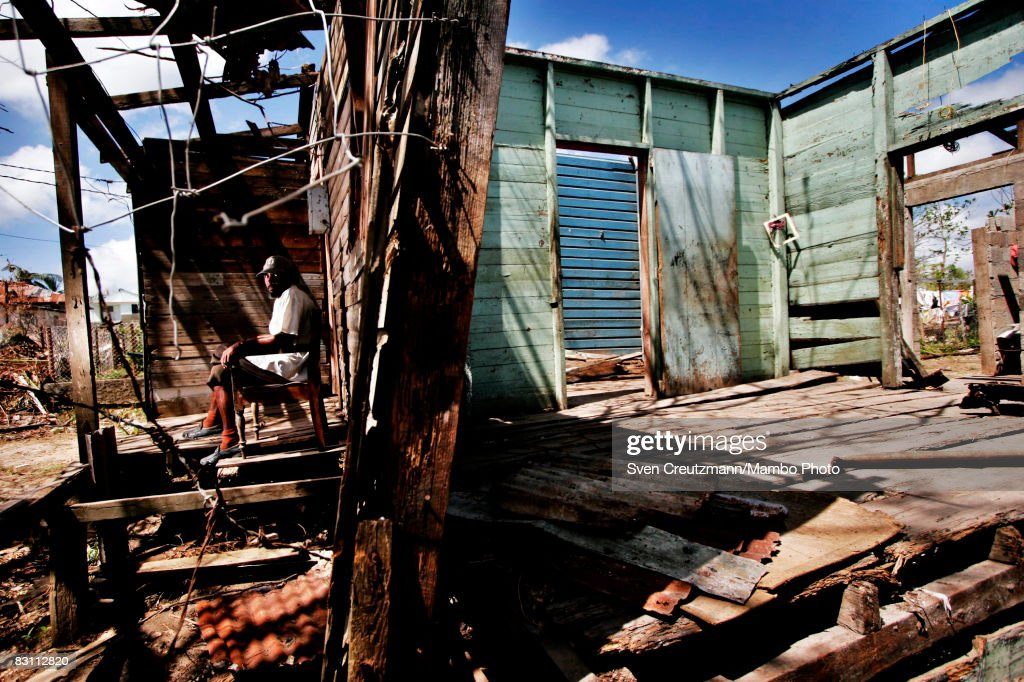 Jose Luis Batista 43yearsold sits amongst the ruin of his house after Hurricane Ike tore through a week earlier September 15 2008 in Banes Cuba Cuba...