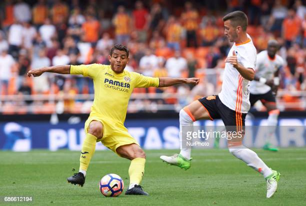 Jose Luis Gaya of Valencia CF and Jonathan Dos Santos of Villarreal CF during their La Liga match between Valencia CF and Villarreal CF at the...