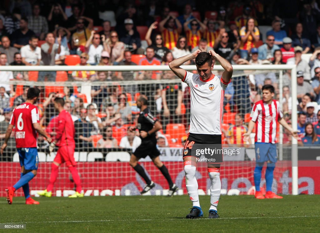 14 Jose Luis Gaya of Valencia CF (C) reacts during the Spanish La Liga Santander soccer match between Valencia CF vs Real Sporting de Gijon at Mestalla Stadium on March 11, 2017.