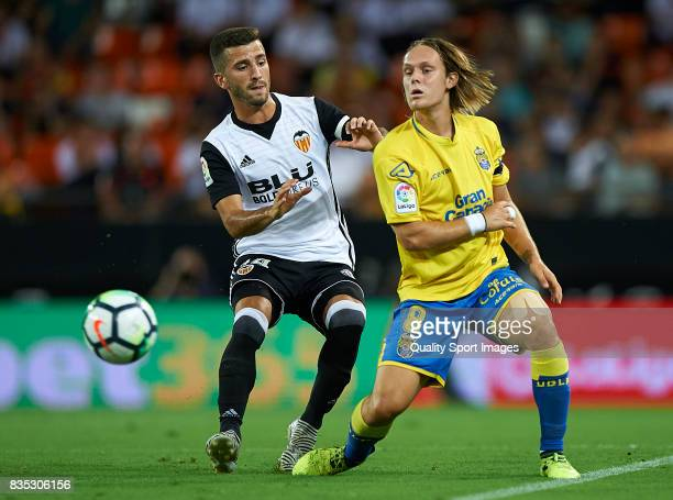 Jose Luis Gaya of Valencia competes for the ball with Alen Halilovic of Las Palmas during the La Liga match between Valencia and Las Palmas at...