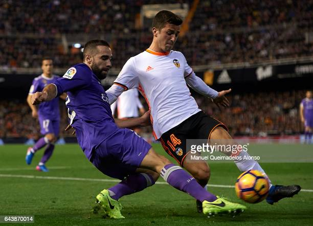 Jose Luis Gaya of Valencia competes for the ball with Daniel Carvajal of Real Madrid during the La Liga match between Valencia CF and Real Madrid at...