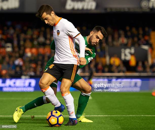 Jose Luis Gaya of Valencia competes for the ball with Pablo Insua Blanco of Leganes during the La Liga match between Valencia CF and CD Leganes at...