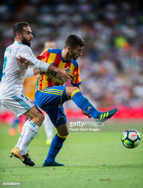 Jose Luis Gaya Pena of Valencia CF fights for the ball with Daniel Carvajal Ramos of Real Madrid during their La Liga 201718 match between Real...