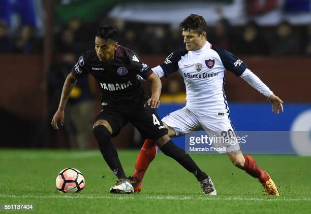 Jose Luis Gomez of Lanus fights for ball with Bautista Merlini of San Lorenzo during the second leg match between Lanus and San Lorenzo as part of...