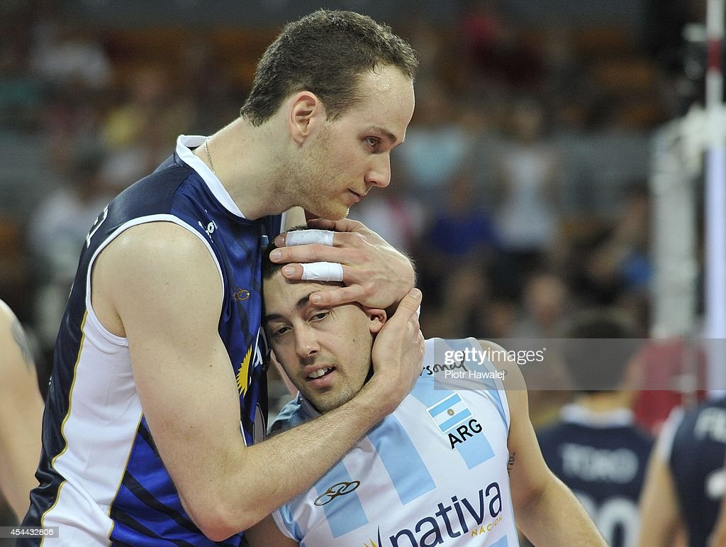 Jose Luis Gonzales /L/ and Sebastian Closter of Argentina celebrate after winning a match during the FIVB World Championships match between Venezuela and Argentina on August 31, 2014 in Wroclaw, Poland.