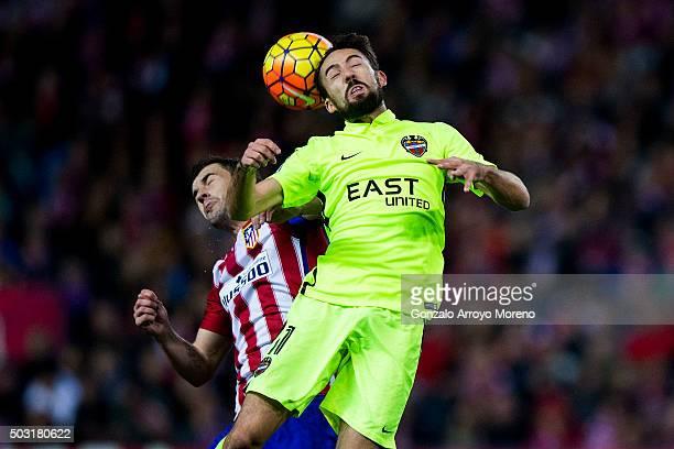 Jose Luis Morales of Levante UD wins the header after Gabi Fernandez of Atletico de Madrid during the La Liga match between Club Atletico de Madrid...