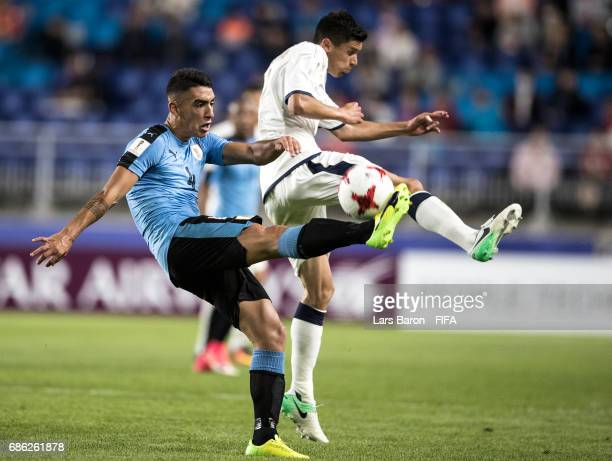Jose Luis Rodriguez of Uruguay is challenged by Matteo Pessina of Italy during the FIFA U20 World Cup Korea Republic 2017 group D match between Italy...