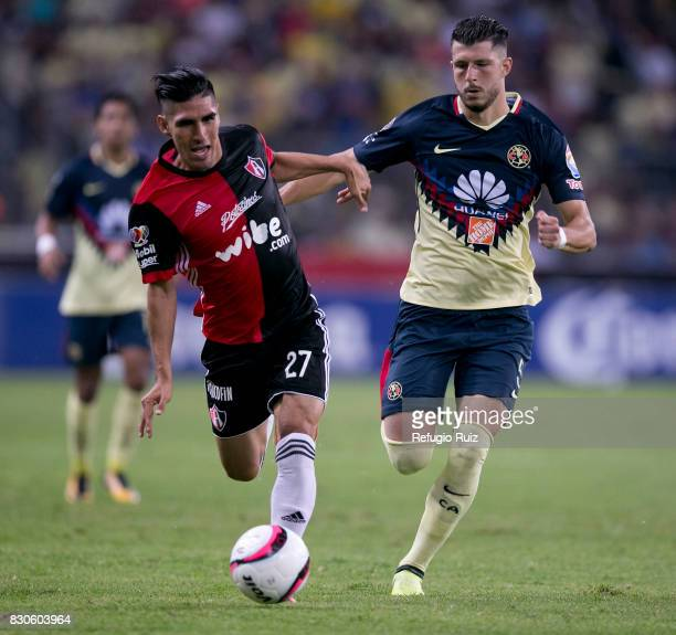 Jose Madueña of Atlas fights for the ball with Guido Rodriguez of America during the 4th round match between Atlas and America as part of the Torneo...