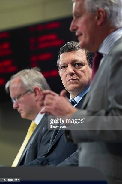 Jose Manuel Barroso president of the European Commission center and Olli Rehn the European Union's economic and monetary affairs commissioner left...