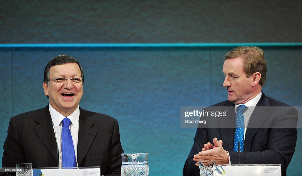 Jose Manuel Barroso, president of the European Commission, left, reacts as Enda Kenny, Ireland's prime minister, applauds during their joint news conference at Dublin Castle in Dublin, Ireland, on Thursday, Jan. 10, 2013. Europe needs to tackle slow growth and high unemployment after laying concerns about the euro's survival to rest, Barroso said. Photographer: Aidan Crawley/Bloomberg via Getty Images