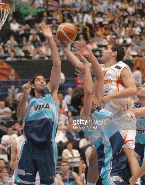Jose Manuel Calderon of Spain gets past Manu Ginobili of Argentina during the FIBA World Championship 2006 Semi Final at the Saitama Super Arena...
