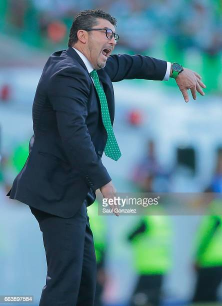 Jose Manuel de la Torre coach of Santos gives instructions to his players during the 12th round match between Santos Laguna and Queretaro as part of...
