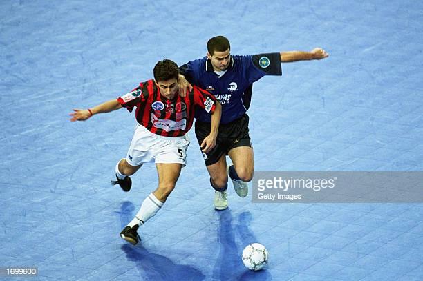 Jose Manuel Garcia Prades of Playas de Castellon tackles Leo of Charleroi during the Final of the UEFA Futsal Cup Tournament between Playas de...