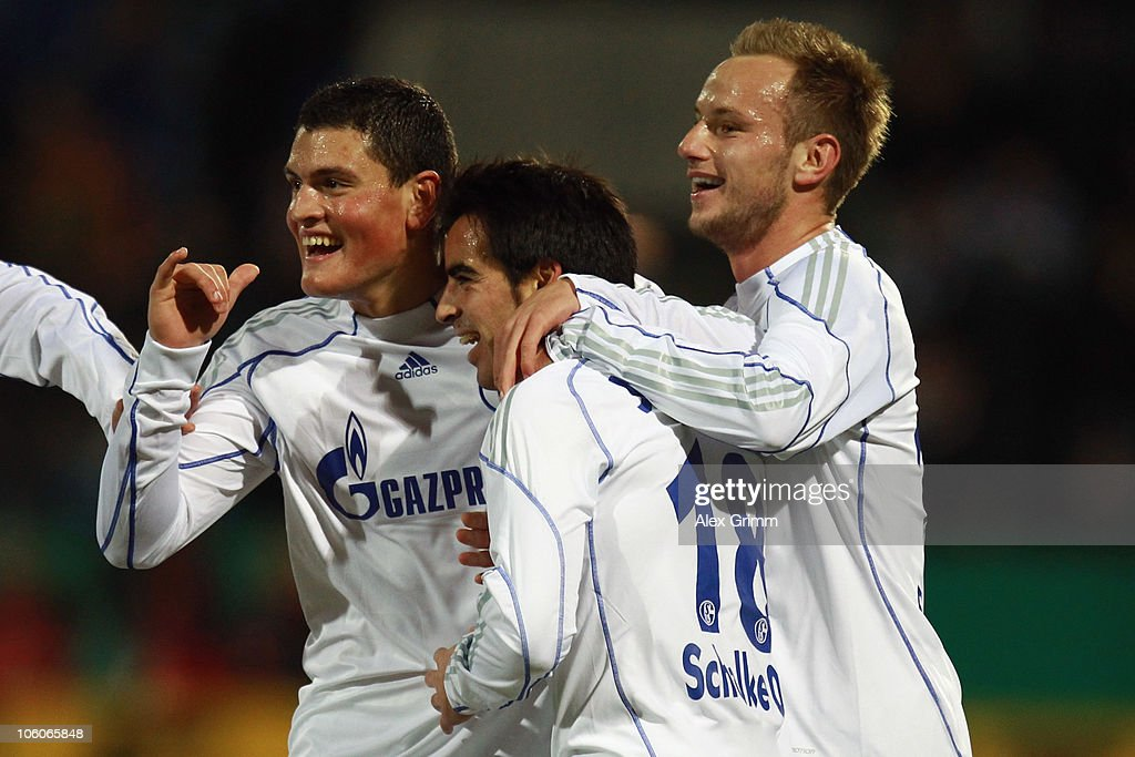 Jose Manuel Jurado (C) of Schalke celebrates his team's first goal with team mates Kyriakos Papadopoulos (L) and Ivan Rakitic during the DFB Cup second round match between FSV Frankfurt and FC Schalke 04 at the Volksbank Stadium on October 26, 2010 in Frankfurt am Main, Germany.